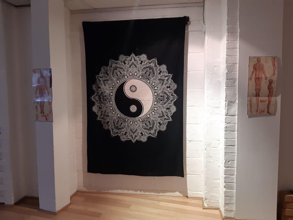 Black and white wall hanging depicting the Yin Yang symbol.